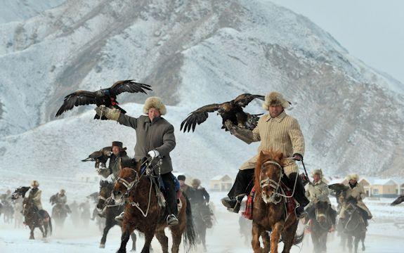Mongolian falconers demonstrate horsemanship
